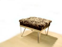Saxum and Isolyn teamed up at the 'New Designer's Exhibition', Business Design Centre, 2002, to create this footstool, celebrating the contrast between natural and inorganic materials.